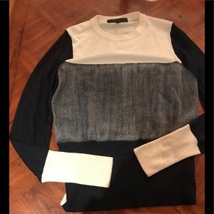 Like new sweater very comfy sleeves a little sheer